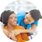 portrait of caregiver and senior woman hugging